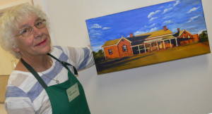 Helen Germeren proudly displaying a painting completed at the U3A Art Day.