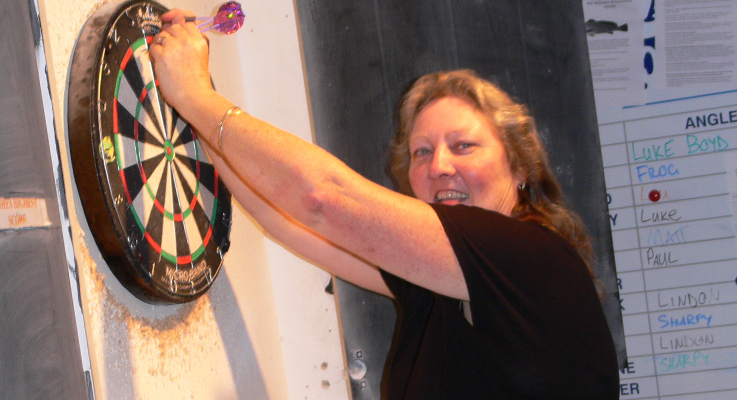 Lyn Pearson showing how to play darts