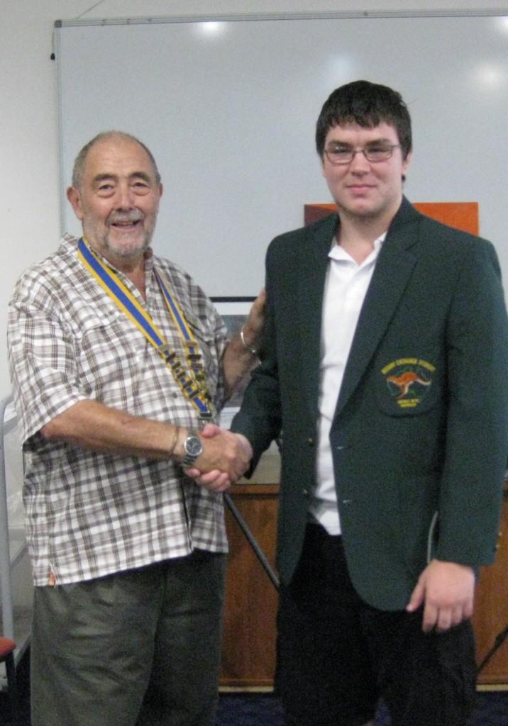 Rotary Club President Geoff Latona presenting Cordel Murphy with his Rotary blazer.