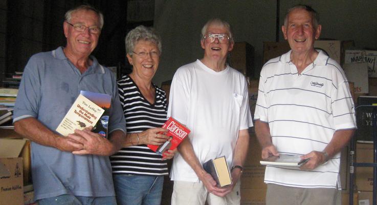 Rotarians Ian Mackenzie-Smith, Bev Latona, Ray Harrison and 2015/16 President Elect Paul Dewar sorting the books generously donated by the Community.