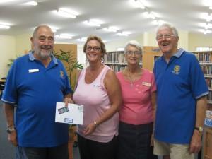 Rotarian Ray Harrison, Rotary President Geoff Latona, Librarian Christine Shelly and Library Volunteer Di Vercoe.