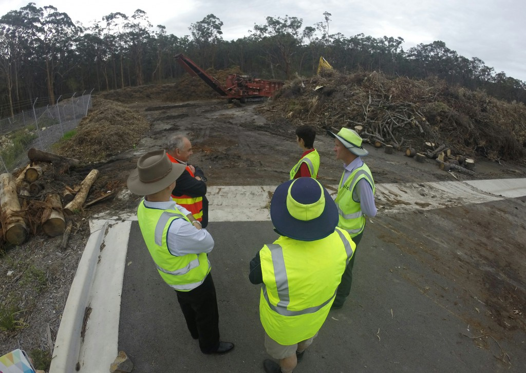 Brigadier Naumann, Cr Len Roberts, Andrew Blatch, Kate Washington MP, Robert Fish view the storm green waste piles at Tea Gardens waste transfer station.