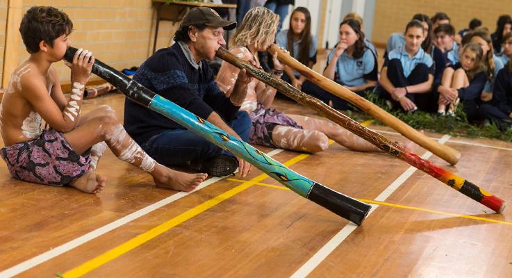 TJ Saunders, Mick Davidson, Matt Williams playing the didgeridoo