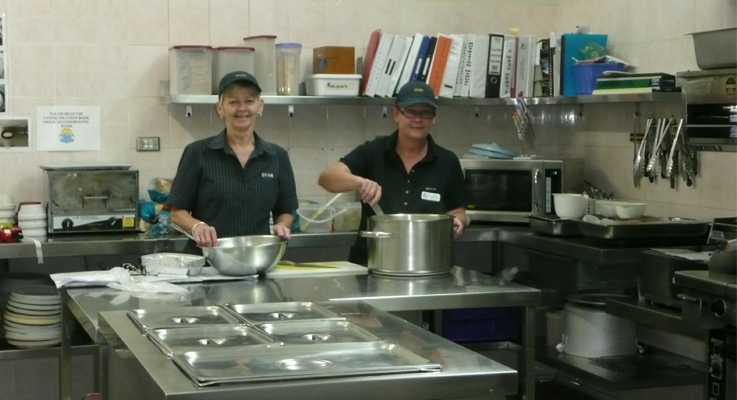 Joanne Sackley and Kim Gregory preparing meals.