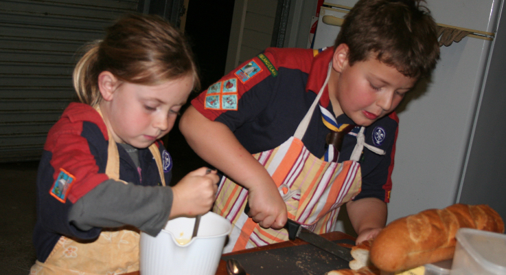 Joeys, Charlie Garemyn and Ezra Hammerl cooking in the Scout kitchen.