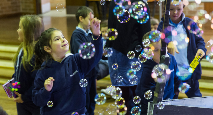 Sofie Whitby bursting bubbles at the Under Sea Book Fair.