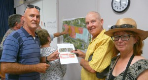 Hawks Nest/Tea Gardens Progress Association President Trevor Jennings with James and Cathriona Kelly from Ezy Kayaks - examining Council's proposed zoning changes.