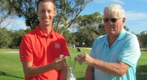 "Hawks Nest Golf Club professional Andrew McCormack and organiser David Gilbert showing just a few of the prizes on offer for ""The Grey Nomads' Cup""."