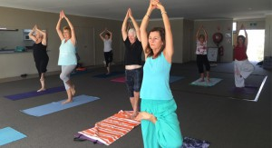 The ladies in class showing good Yoga form while raising money for Laos children.