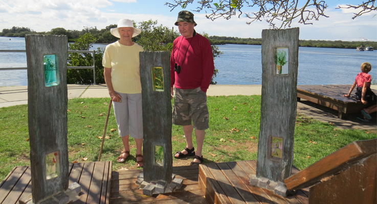 q ENJOYING: Pam and Tom Lindsay from North Arm Cove view Windows in the Wood, one of the many art works along the Myall River Art Walk.