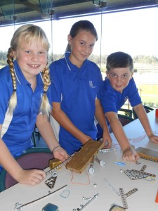 Maggie Cunich, Amber Cunningham and Toby Barry construct a Mars Rover in the transportation category.