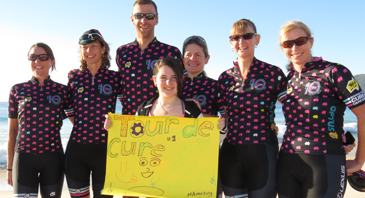 q WELCOME: Roxy McAliece from Hawks Nest welcomes the Tour de Cure cyclists including triple Olympic Gold Medallist Drew Ginn.