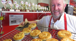 Champion Baker, Milton Churchill with his award-winning baked goods.