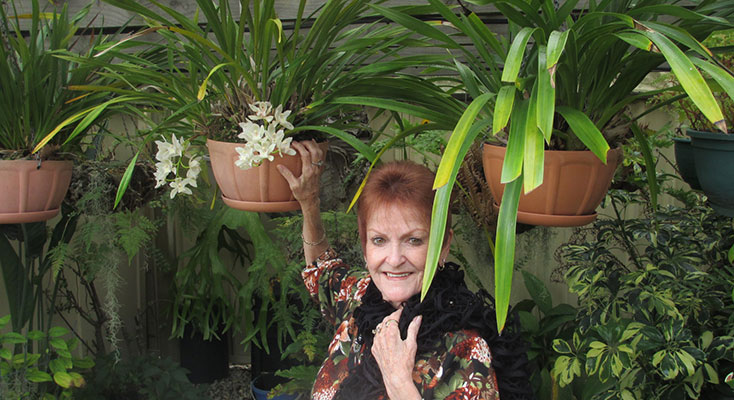 AMedowie Gardens Club member showing off the beautiful hanging plants