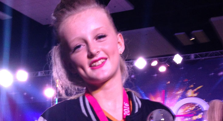 CHAMPION CHEERLEADER: Georgia Almond holding her Grand Champion cheerleading trophy.