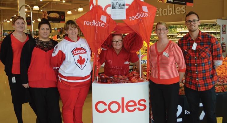 Coles Medowie employees supporting Redkite Day all dressed in Red for the special event
