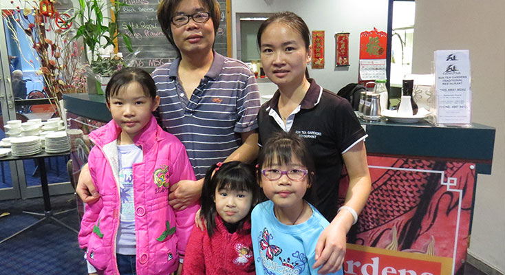 George and Jian Deng with their daughters Kim, Melissa and Heidi.