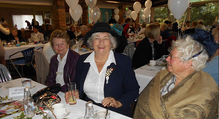 Lioness Mary Fairhall sitting with Raylene Partridge and Jill Parker in gold.