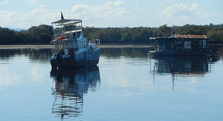 Large vessel in the Myall River had been driven on to the sand flats.