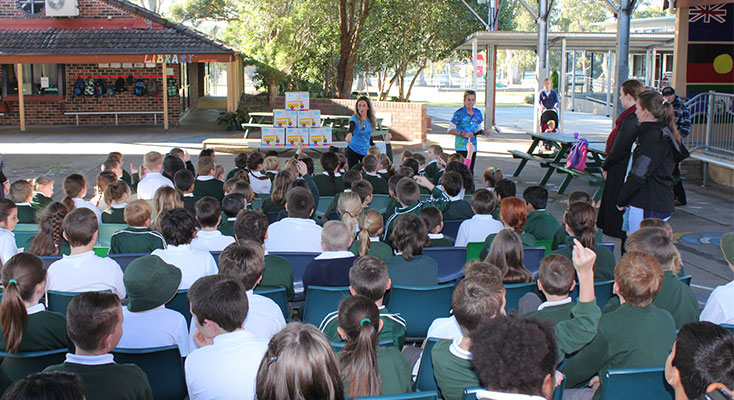 Yoobi addresses students at KPS