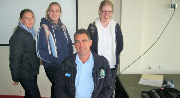 Tamara Gooch, Shae Finch and Kaitlyn Gregory discuss road safety issues with Senior Constable David Russell.