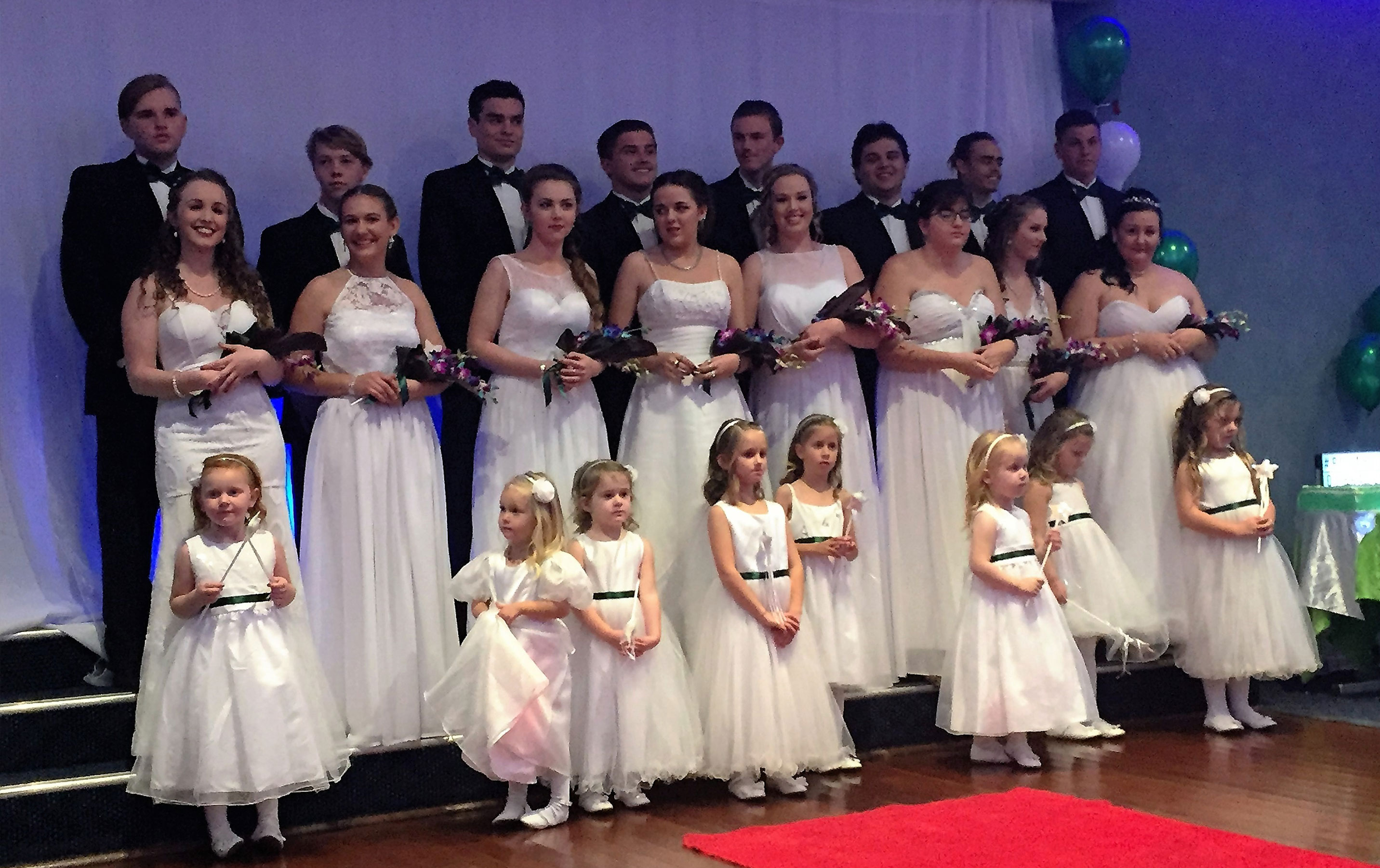 Sarah Rooney, Tamara Gooch, Taylor Garemyn, Bonnie Hay, Shae Finch, Alarnie Hawkins, Bianca Mason and Keahne Hurtado with their partners and flower girls.