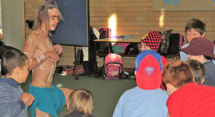 CULTURE: Tea Gardens Public School students perform with Matthew Williams.