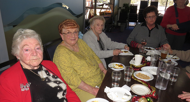 CHRISTMAS TRADITION: Members of the Myall Dolphins enjoy the traditional plum pudding.