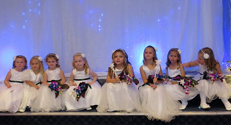 FLOWER GIRLS: Debutante girls dressed in white.