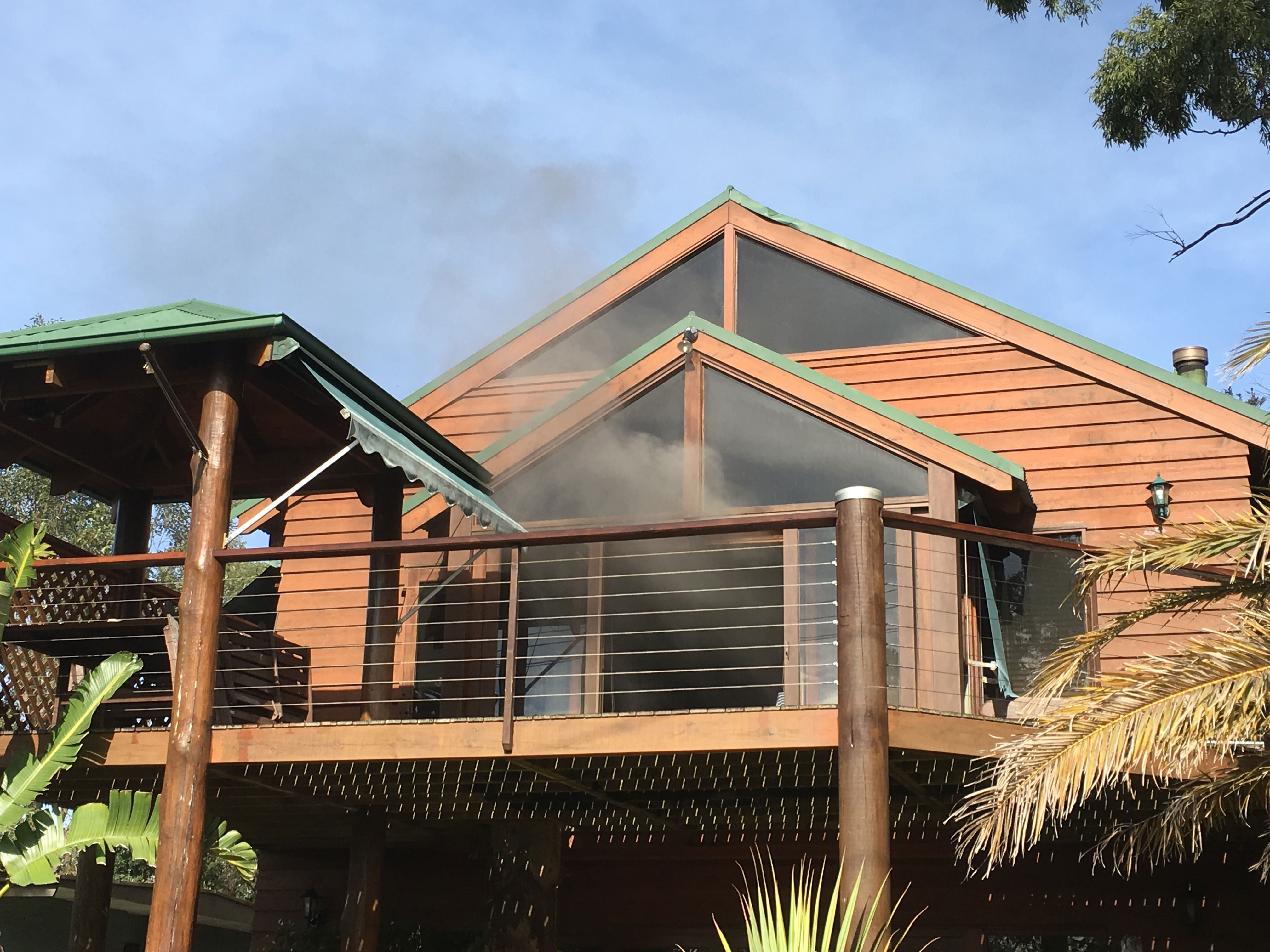 Smoke billowing from the upper level of the premises in Karthena Stree Hawks Nest.