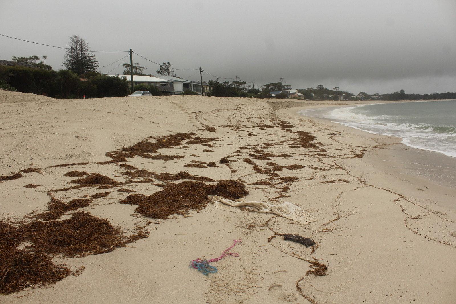 Debris and erosion on the beach.