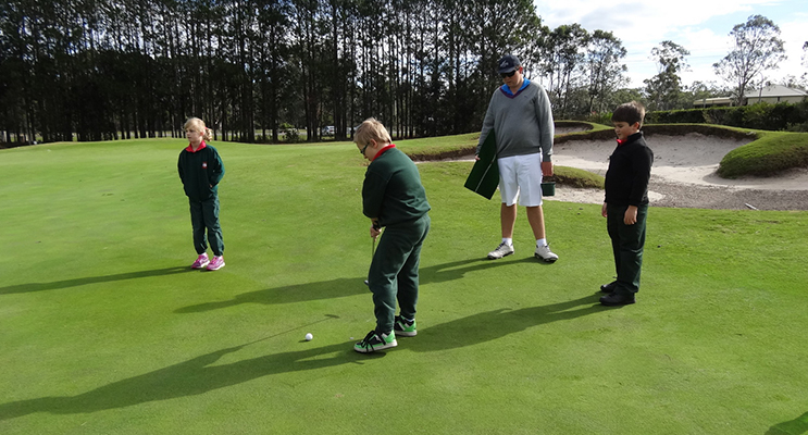 YOUNG GOLFERS: Bobs Farm students receiving putting tips