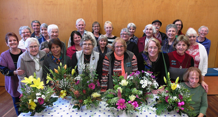 Demonstrating some of the acquired skills in flower arranging.