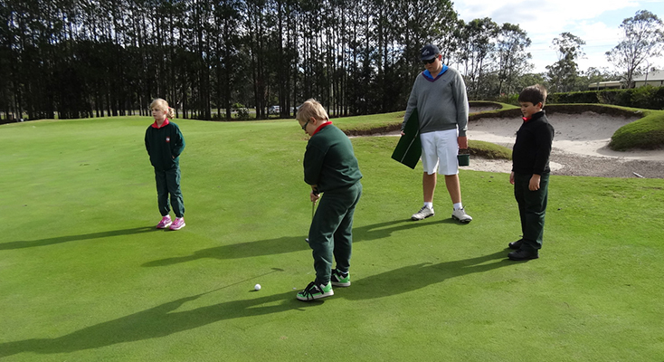 Bobs Farm students receiving putting tips