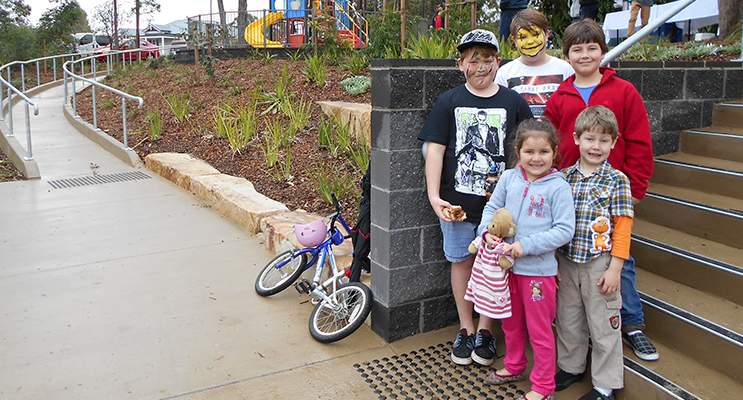 Maverick Toby, Nick Patten and Asher, Gabriel and Leviah Lee enjoying the new park.