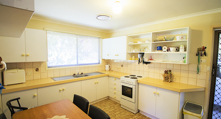 The main hub of the home is its tidy kitchen and open lounge room.