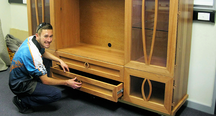 CONSTRUCTION: Jayden Lilley with his Entertainment Unit constructed for the HSC.
