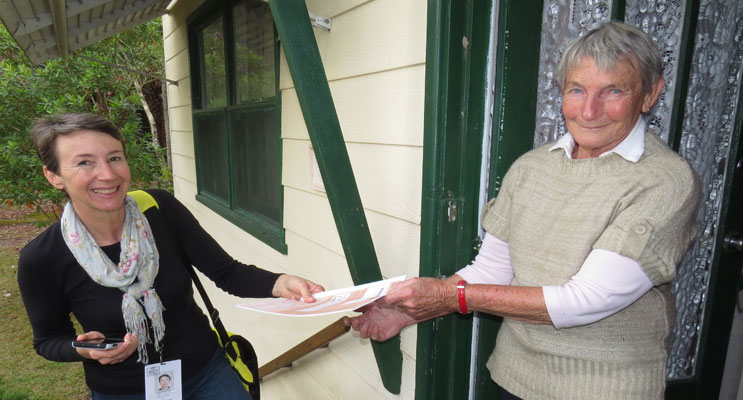 A local Field Officer delivers a Census form to Carol Tattersall.