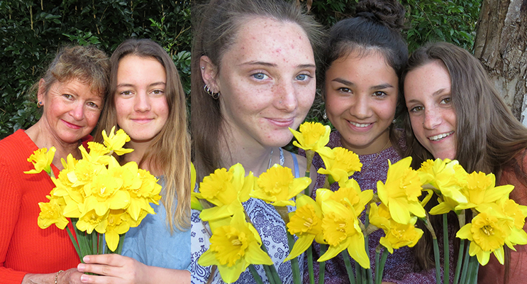 DAFFODIL DAY: Cancer survivor Debbie Smart and her daughter Kaitlyn.(left)SOMEONE I KNOW: Kaitlyn Osborne, Megan Markham and Marley Mezi support Daffodil Day for ( right)