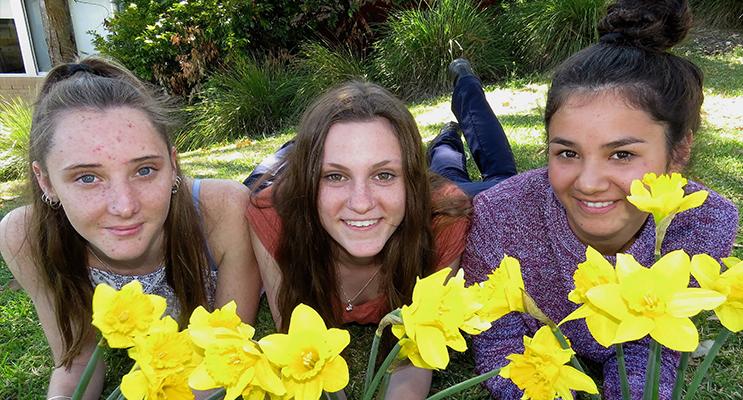 SOMEONE I KNOW: Kaitlyn Osborne, Megan Markham and Marley Mezi support Daffodil Day for