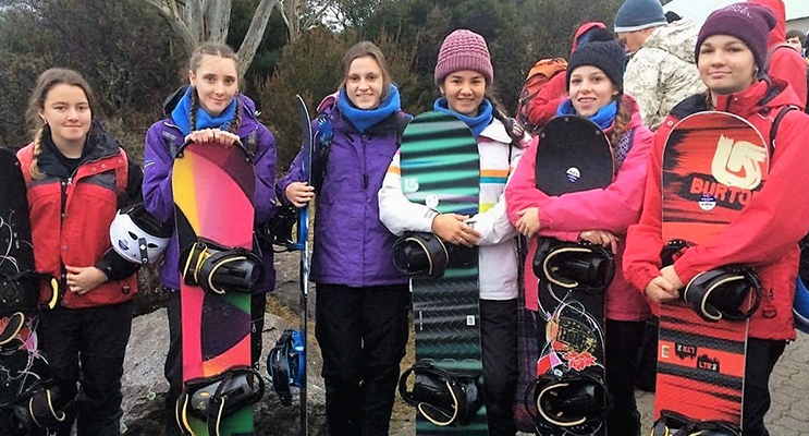 SNOWBOARD: BCS Year 11 students Kaitlyn Smart, Megan Markham, Kaitlyn Osborne, Marley Mezi and Madisson Morante from Tea Gardens with Rachel Rae from Wootton in Jindabyne.