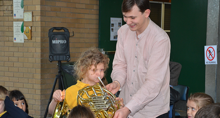 MUSIC: TGPS student plays the French horn.