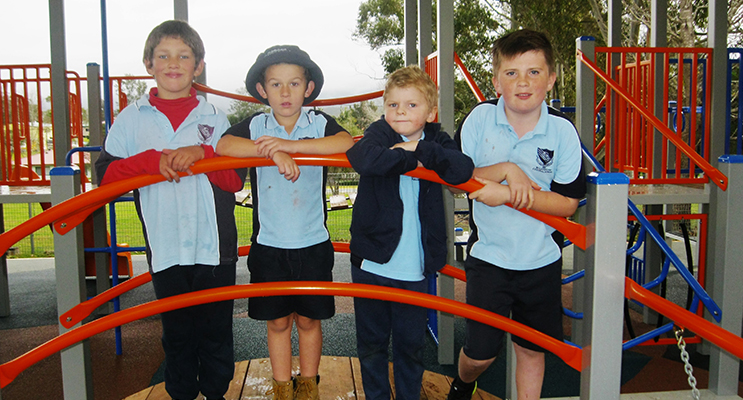 PLAY: Tristan Crittenden, Jai Thompson, Zackery Moran and Toby Barry on the new playground equipment unveiled during BCS Open Day Celebrations.