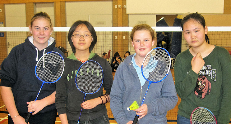 OLYMPICS: BCS badminton tournament between Jordyn Watt and Emma McLoughlin and visiting students Mikayla and Zinc from China.
