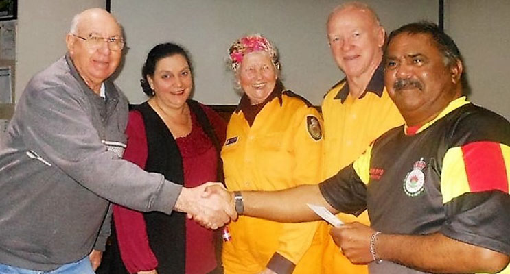 DONATION: Fred McInerney, Karen Kucera, Elizabeth Delbridge, Acting Brigade Captain Ken Smee and Treasurer David Feeney.