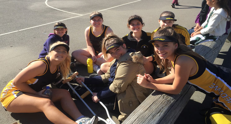 Some of the Medowie Netball players modelling a new sunSmart cap which was purchased through a grant from Port Stephens Council.