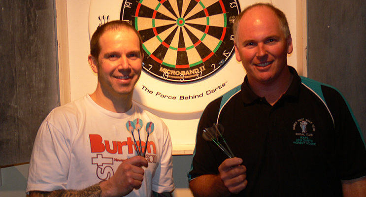 Michael Russom and Darren Rapley after their doubles darts win.