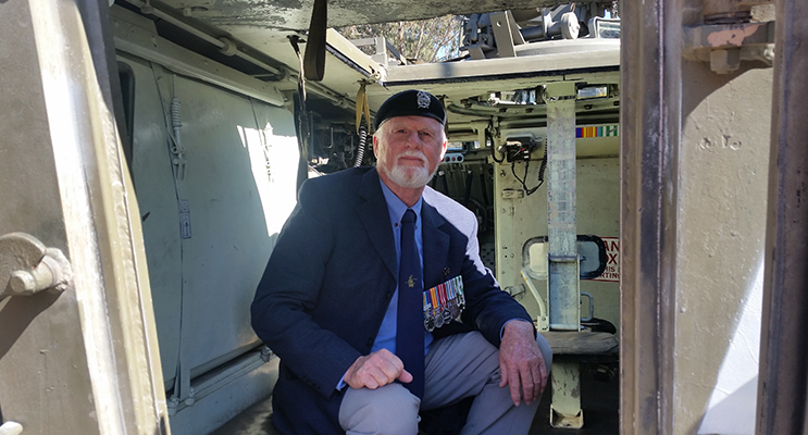 Tea Gardens Vietnam Veteran Bruce Chapman sitting inside an armoured personnel carrier from the battle of Long Tan.