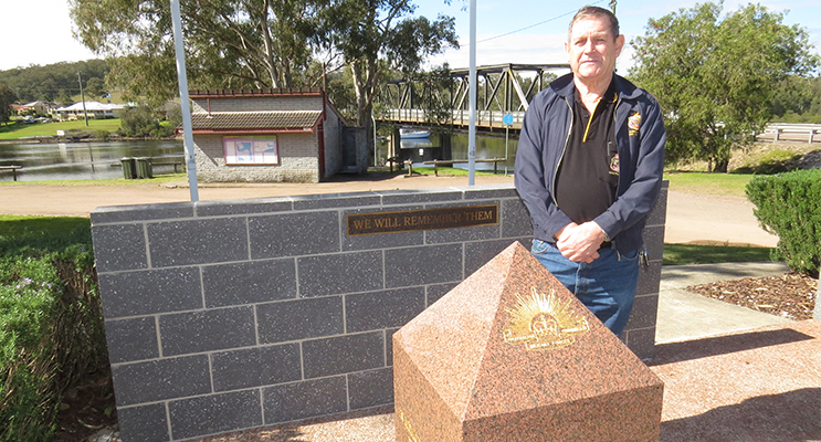 TRIBUTE: Karuah RSL Sub Branch President Mr Peter Fidden at the new Commemorative Wall.