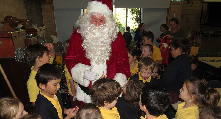 CHRISTMAS: Students enjoyed a visit from Santa during the Christmas in July Celebration.